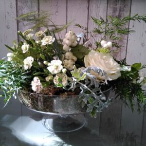 Flores en frutero de cristal